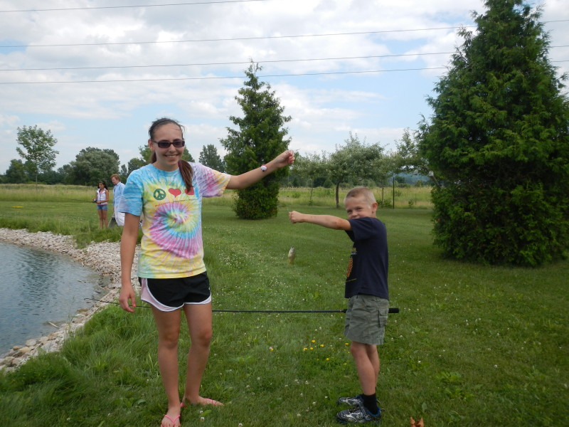 Ashley Abts helps young fisherman