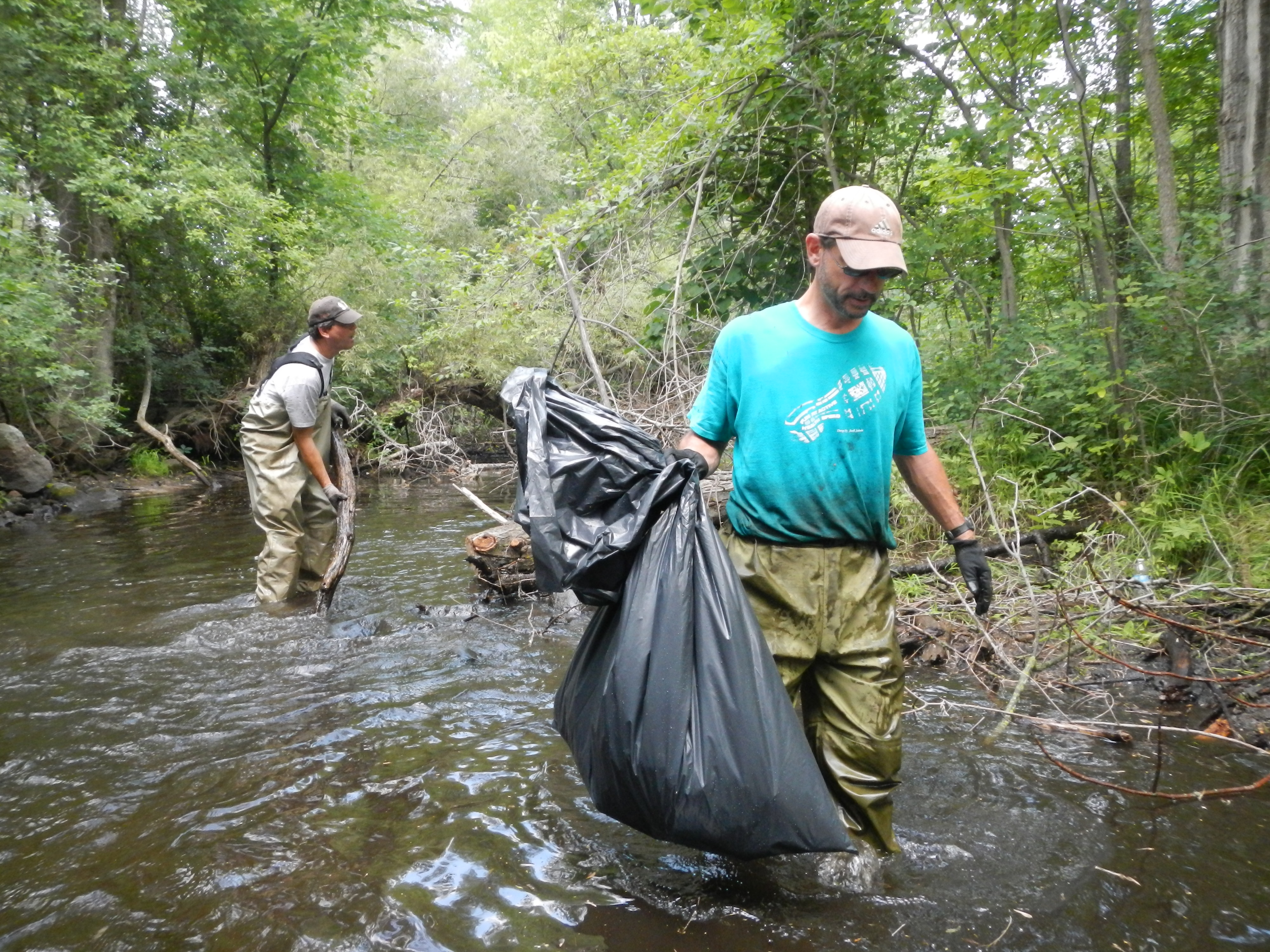 Jeff House and Dave Ostanak carry of debris and trash