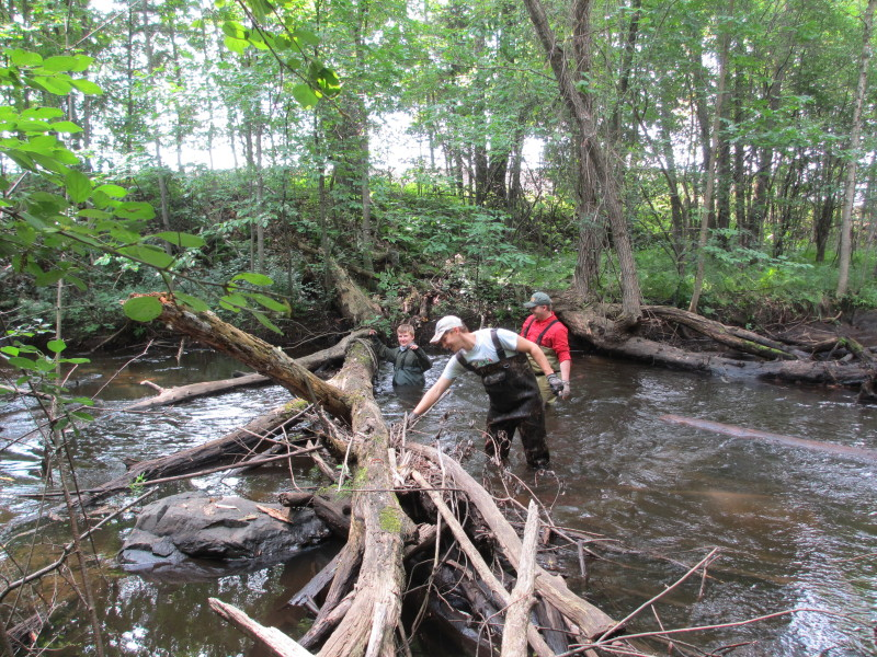 Mike Stone, Noel Craig and Jeff Stone work to clear another log jam