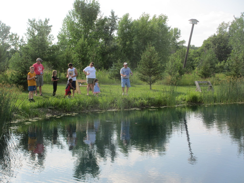 A group of fisherfolk trying the larger pond