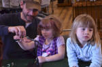 Dave helping sisters tie their first fly. Boring....