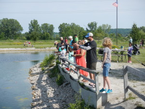 Volunteers and optimistic anglers ready for fish.