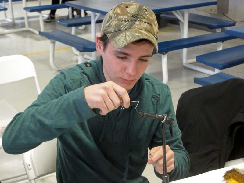 Sam demonstrating how to use a whip finishing tool