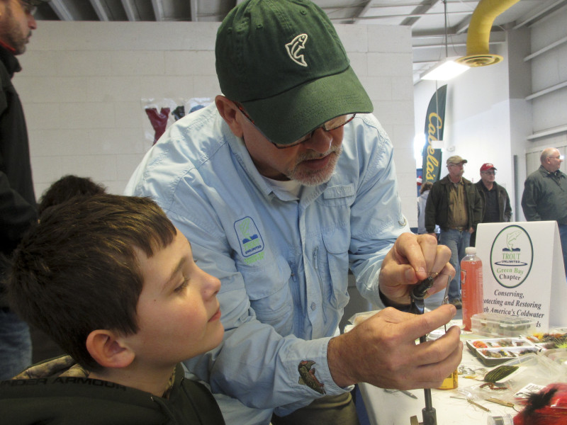 Mike Renish demonstrating some fly tying techniques