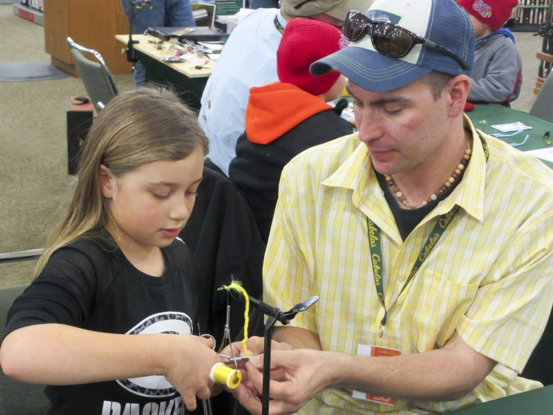 Adrian working with young lady on Panfish Bugger