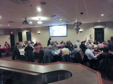 Attendees enjoying ribs, chicken and music
