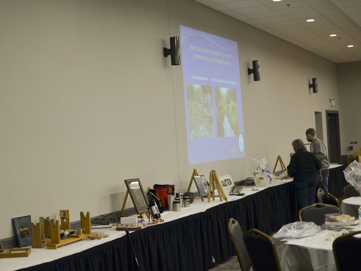 Janet and John put finishing touches on silent auction table